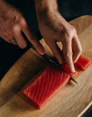cutting raw tuna steaks